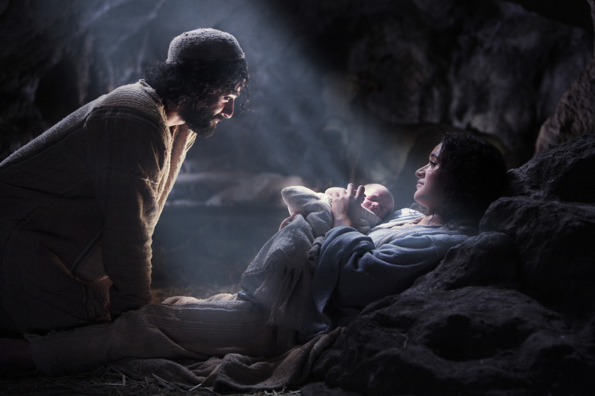 Joseph looking at Mary holding the Baby Jesus